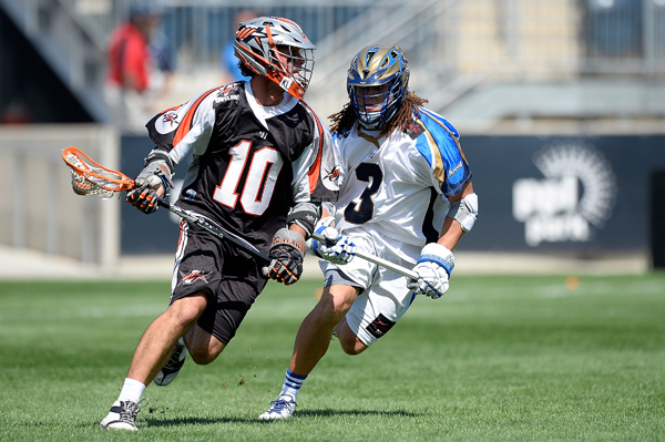 CHESTER, PA - AUGUST 24:  Chris Bocklet #10 of the Denver Outlaws controls the ball against Josh Hawkins #3 of the Charlotte Hounds during the 2013 MLL Semifinal game at PPL Park on August 24, 2013 in Chester, Pennsylvania.  (Photo by Patrick McDermott/Getty Images)